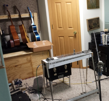 Studio shot with guitars and pedal steel